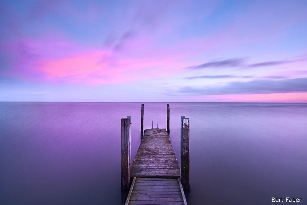 Zonsondergang aan de waddendijk