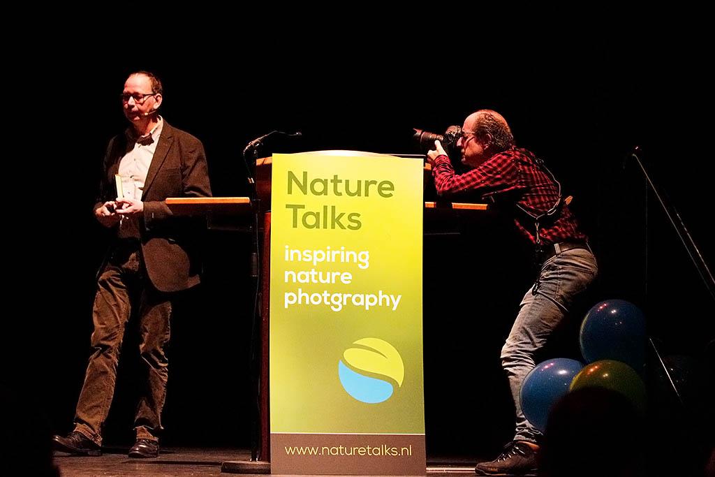 Fotograaf Wim Wilmers fotografeert spreker Jan Vermeer